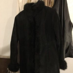 Mid length fur lined Suede coat.